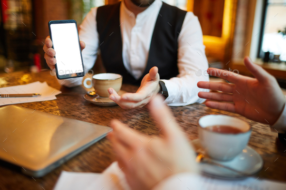 Businessman Showing Mobile App - Stock Photo - Images