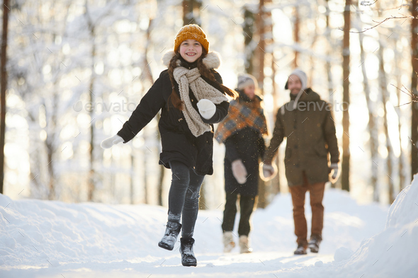 Happy Girl Running in Winter Forest - Stock Photo - Images