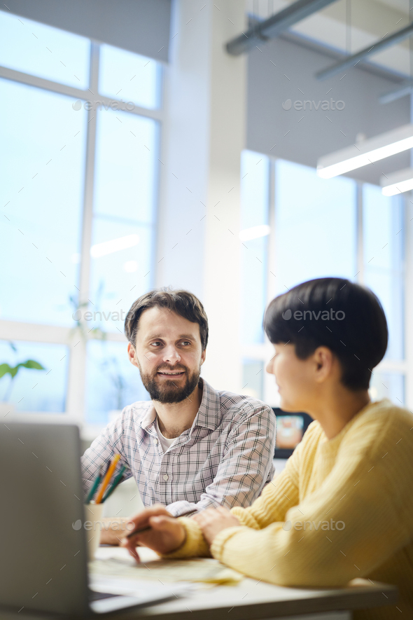 Hipster colleagues discussing ideas in office - Stock Photo - Images