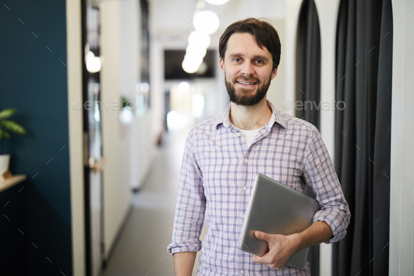 Cheerful successful entrepreneur with laptop - Stock Photo - Images