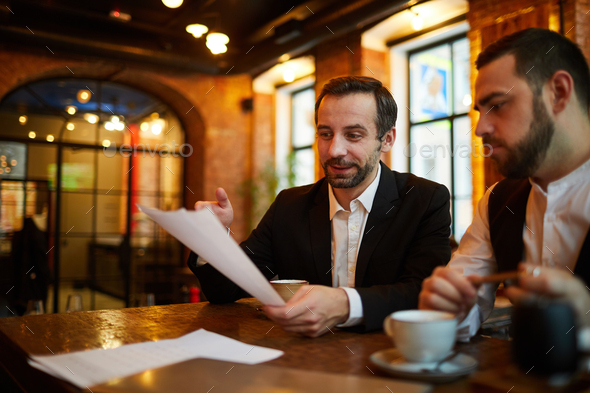 Business Meeting in Restaurant - Stock Photo - Images