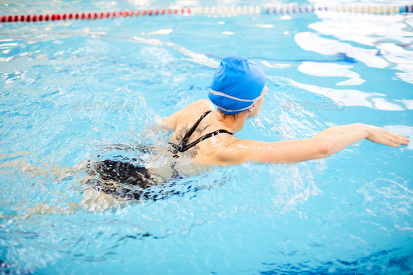 Woman Swimming in Pool - Stock Photo - Images
