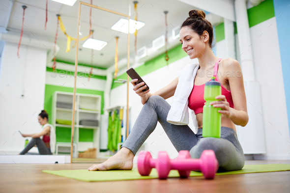 Young Woman Relaxing after Workout - Stock Photo - Images