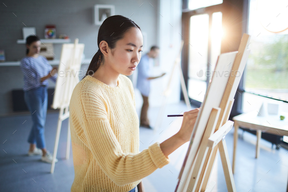 Girl by easel - Stock Photo - Images