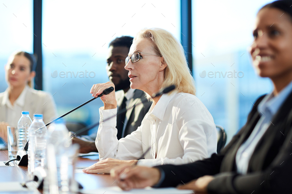 Talking to speaker - Stock Photo - Images