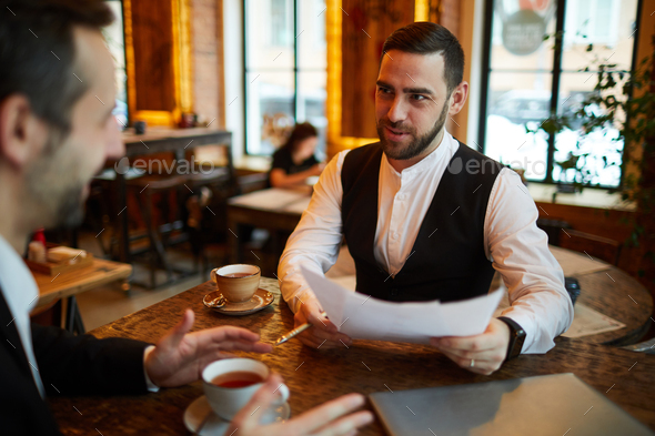 Two Businessmen Meeting in Cafe - Stock Photo - Images