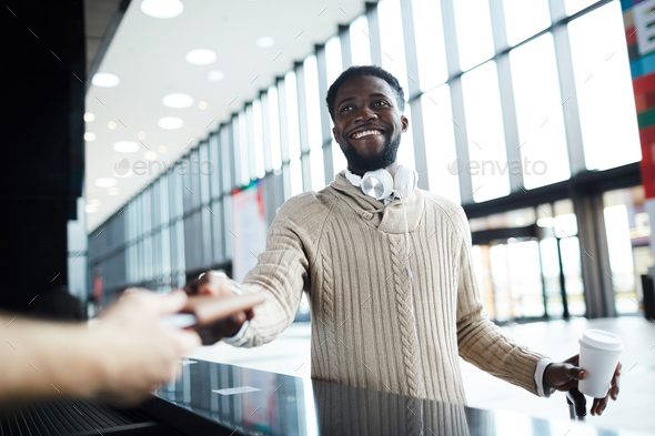 Traveler by check-in counter - Stock Photo - Images