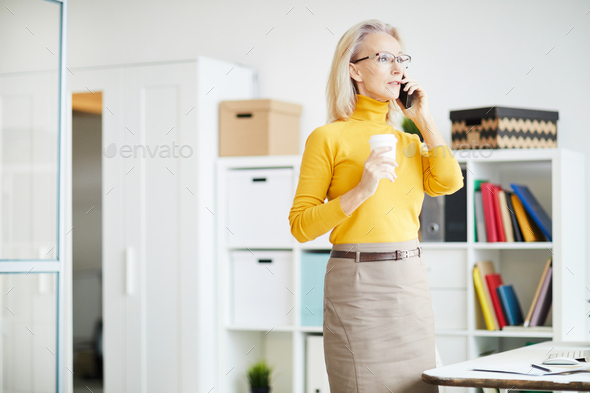 Mature Businesswoman Speaking by Phone - Stock Photo - Images