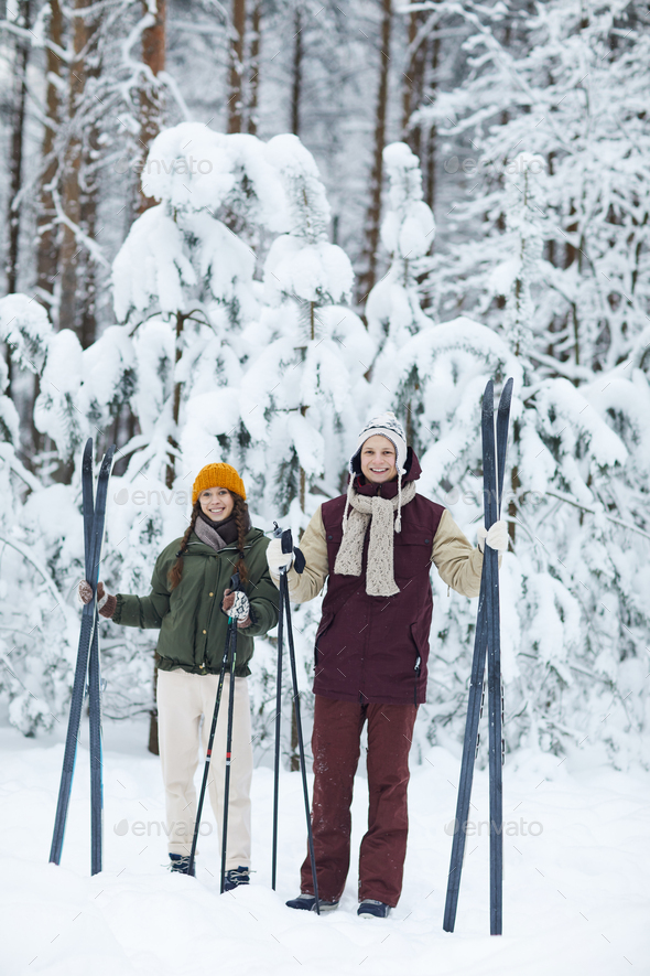 Sportive Couple Skiing in Winter - Stock Photo - Images