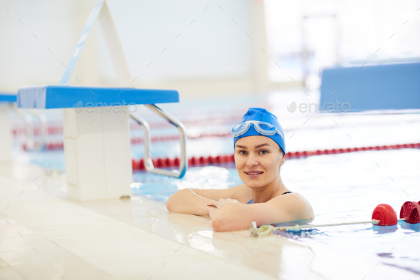Woman Posing in Swimming Pool - Stock Photo - Images