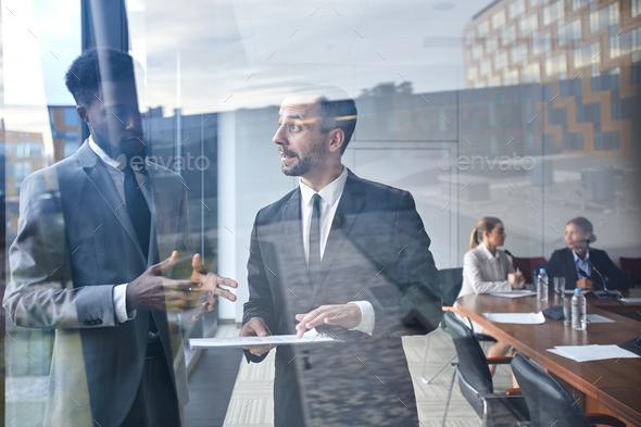 Negotiating at meeting - Stock Photo - Images