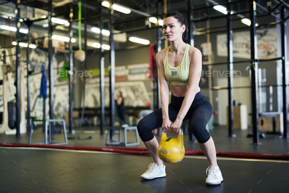 Exercising in fitness center - Stock Photo - Images
