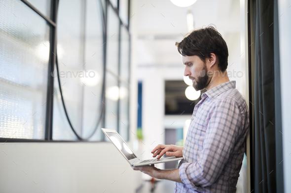 Man focused on online data - Stock Photo - Images