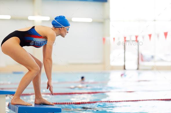 Female Swimmer on Start - Stock Photo - Images