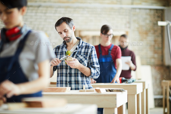 Measuring wooden detail - Stock Photo - Images