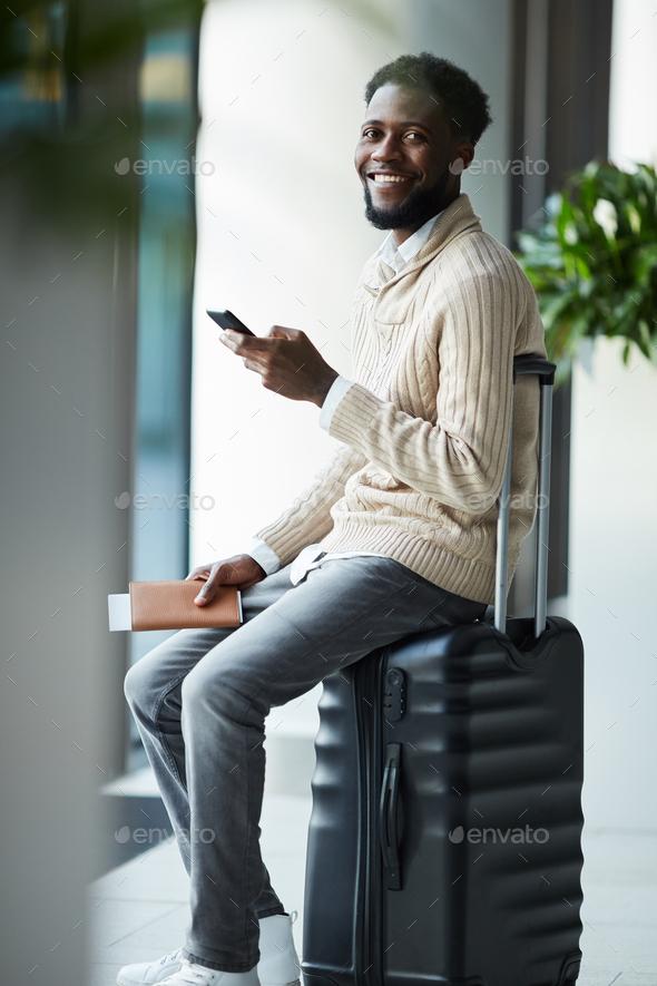 Traveler on suitcase - Stock Photo - Images