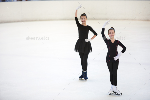 Two Figure Skaters Posing in Competition - Stock Photo - Images