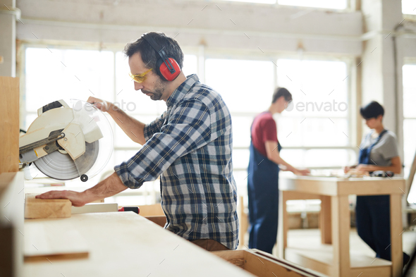 Using circular saw in workshop - Stock Photo - Images