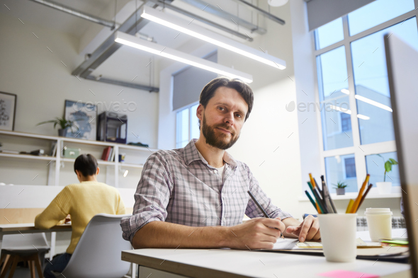 Content male designer working on project - Stock Photo - Images