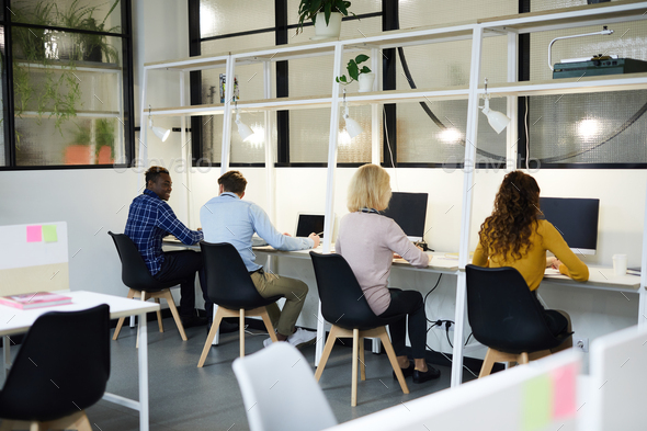 Business people sitting in row - Stock Photo - Images