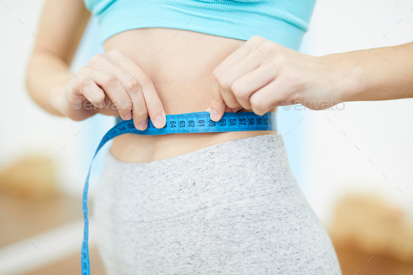Unrecognizable Woman Measuring Waist in Gym - Stock Photo - Images