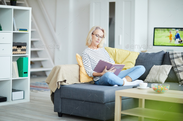 Mature Woman Relaxing at Home - Stock Photo - Images
