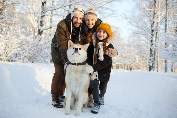 Family Posing with Dog Outdoors - Stock Photo - Images