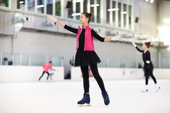 Teenage Asian Girl Figure Skating - Stock Photo - Images