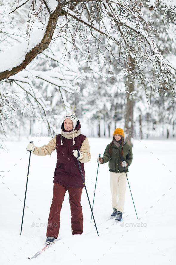 Couple Enjoying Skiing - Stock Photo - Images