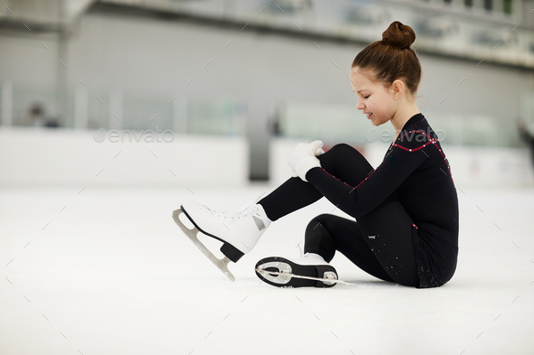 Injured Girl on Ice Rink - Stock Photo - Images