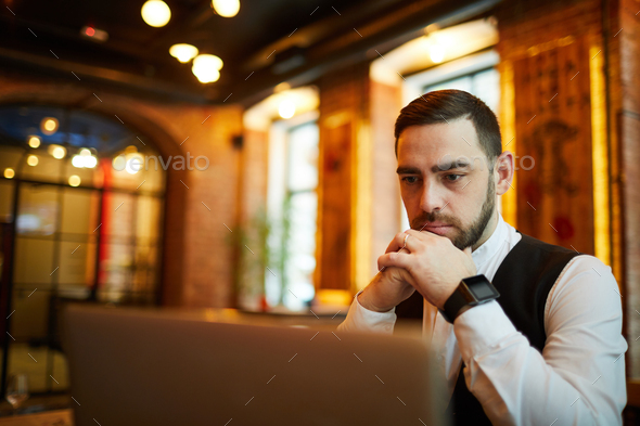 Thoughtful Businessman in Cafe - Stock Photo - Images