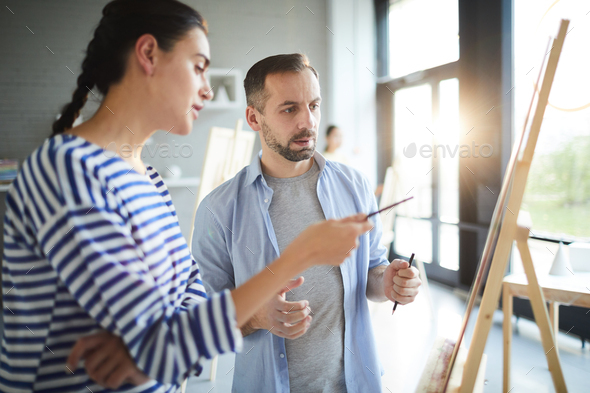 Conversation by easel - Stock Photo - Images