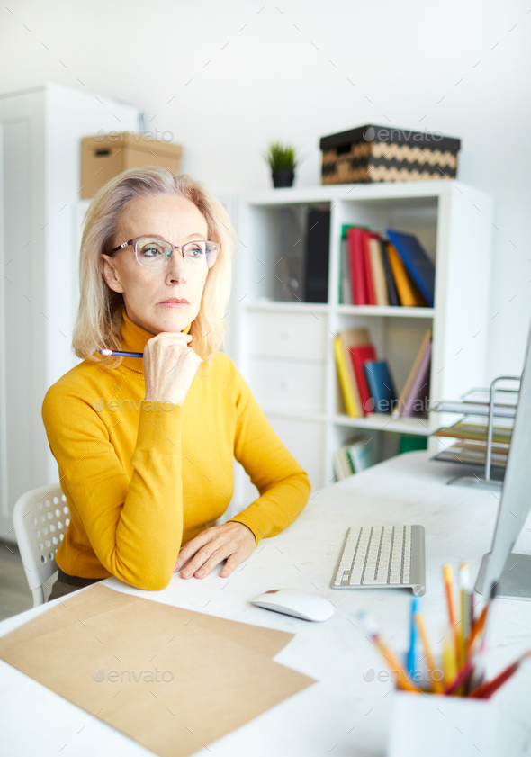 Pensive Female Manager - Stock Photo - Images