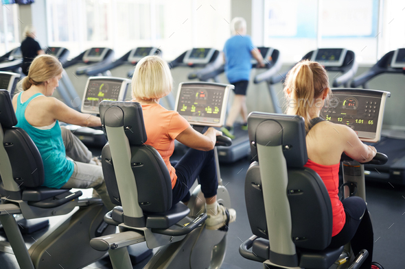 Training on fitness bicycles - Stock Photo - Images
