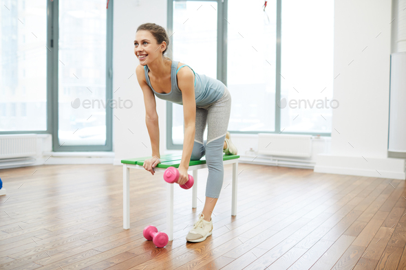 Pretty Woman Execrcising in Gym - Stock Photo - Images