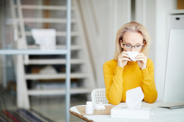 Sick Businesswoman at Work - Stock Photo - Images