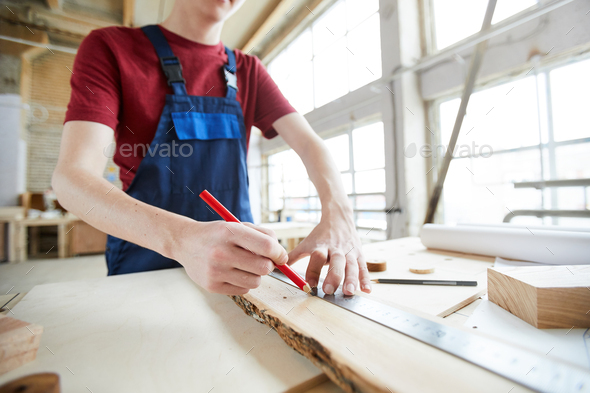 Making marks on wooden plank - Stock Photo - Images