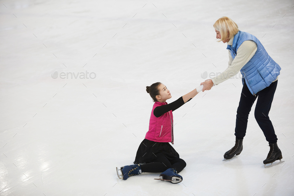 Woman Helping Girl Get up - Stock Photo - Images