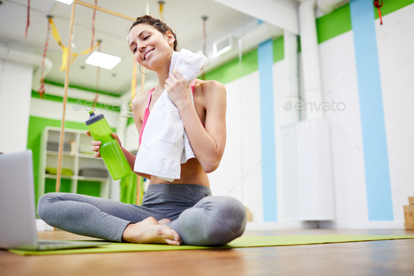 Refreshed Woman in Gym - Stock Photo - Images