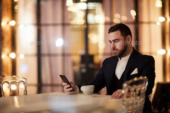 Handsome Gentleman Waiting in Restaurant - Stock Photo - Images