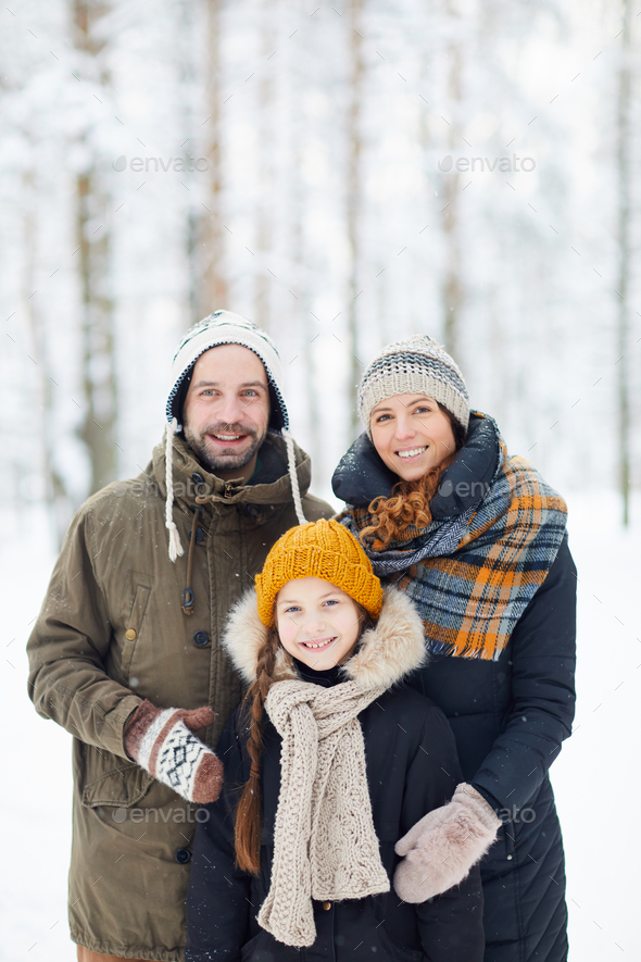 Happy Family in Winter Forest - Stock Photo - Images