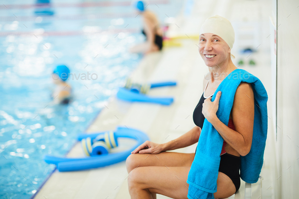 Senior Woman Resting by Pool - Stock Photo - Images
