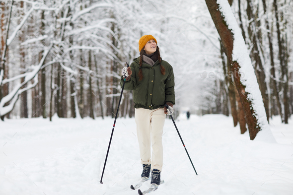 Cheerful Woman Skiing in Forest - Stock Photo - Images