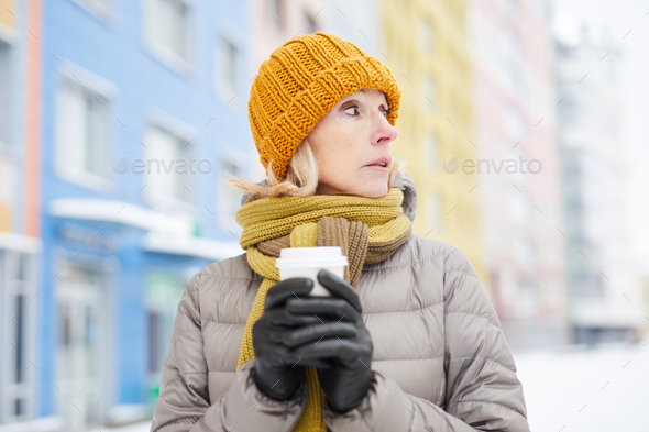 Woman drinking Coffee in Winter - Stock Photo - Images