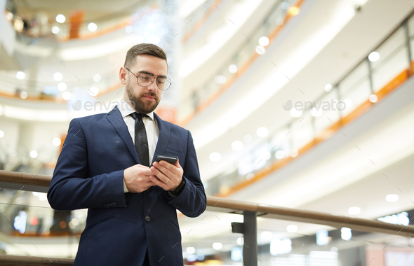 Texting in trade center - Stock Photo - Images