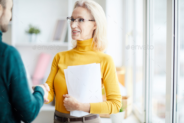 Female Boss Shaking Hands with Partner - Stock Photo - Images