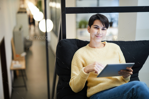 Pretty lady using tablet in cozy office - Stock Photo - Images