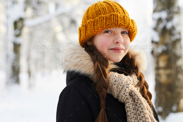 Little Girl in Winter Forest - Stock Photo - Images