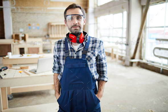 Content handsome carpenter in workshop - Stock Photo - Images