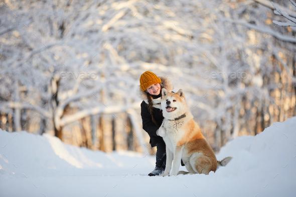 Girl Posing with Akita Dog - Stock Photo - Images